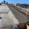 Concrete Placement in Progress for Deck and Barrier Retrofit - March 2021